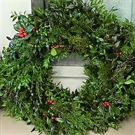 A handmade wreath of Virginia greenery