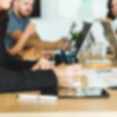 woman-taking-notes-during-team-meeting.j