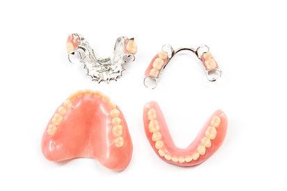 removable partial denture on white backg