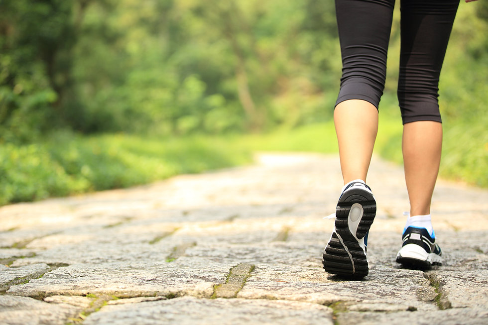 young fitness woman legs walking at fore