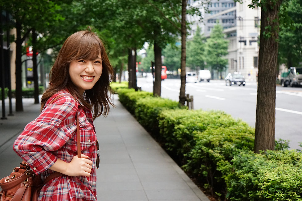 Young Asian girl traveling alone with sm