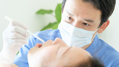 young dentist treating patient teeth at