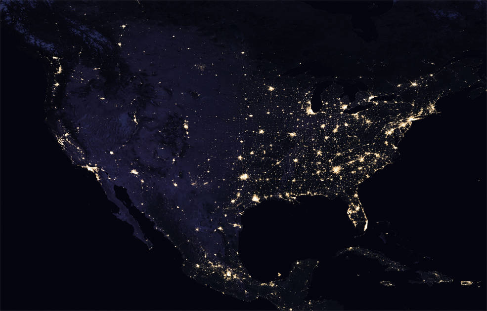Picture of North America with bright spots indicating large metropolitan areas