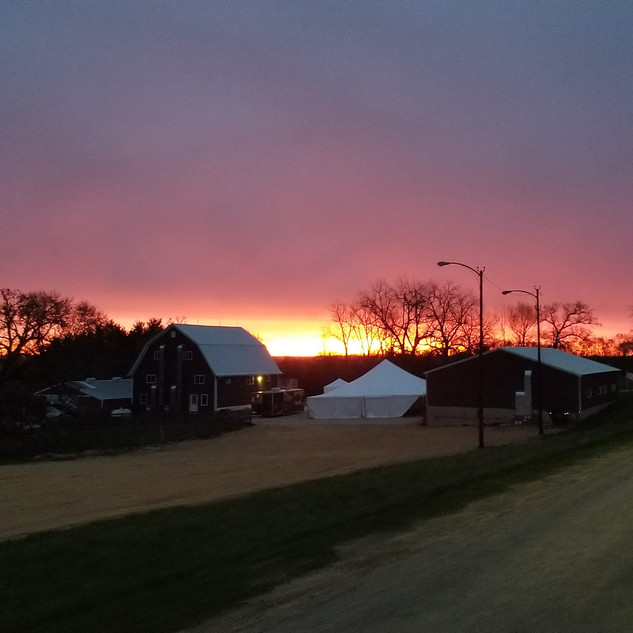 Tent and Barns during sunrise