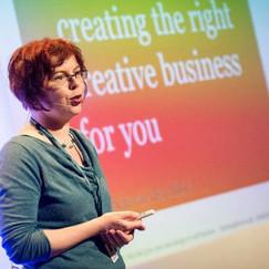 Patricia van den Akker in mid-presentation