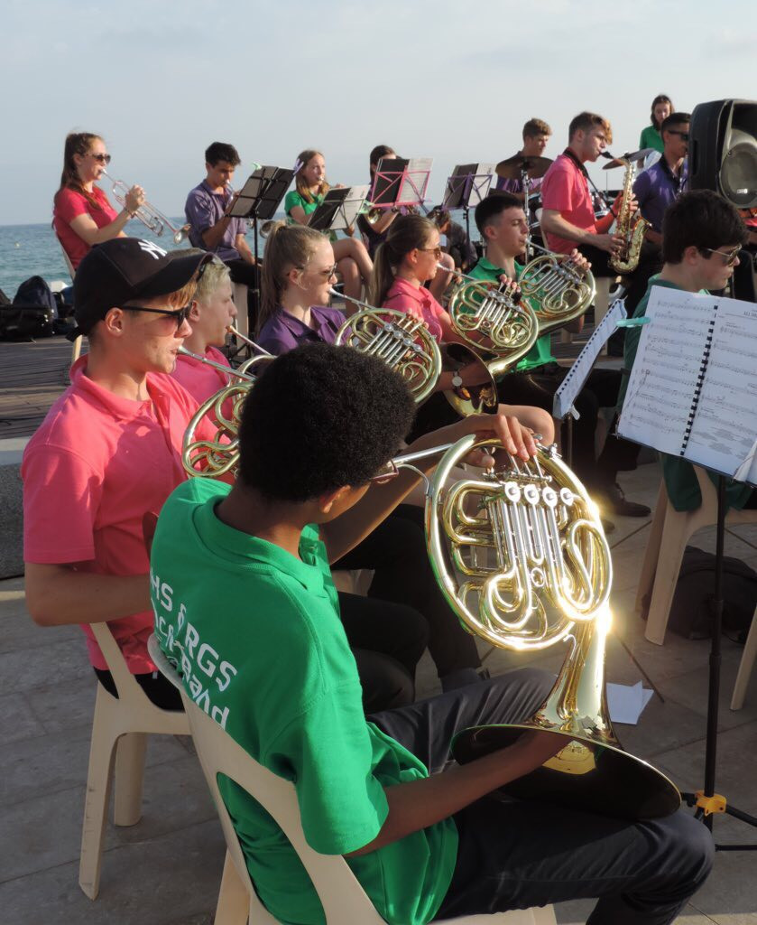 Performing by the sea in Salou, Gower Music Tours