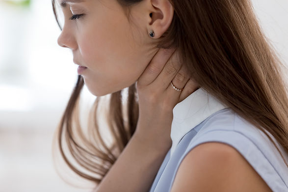 Unhealthy young woman touch neck hard to
