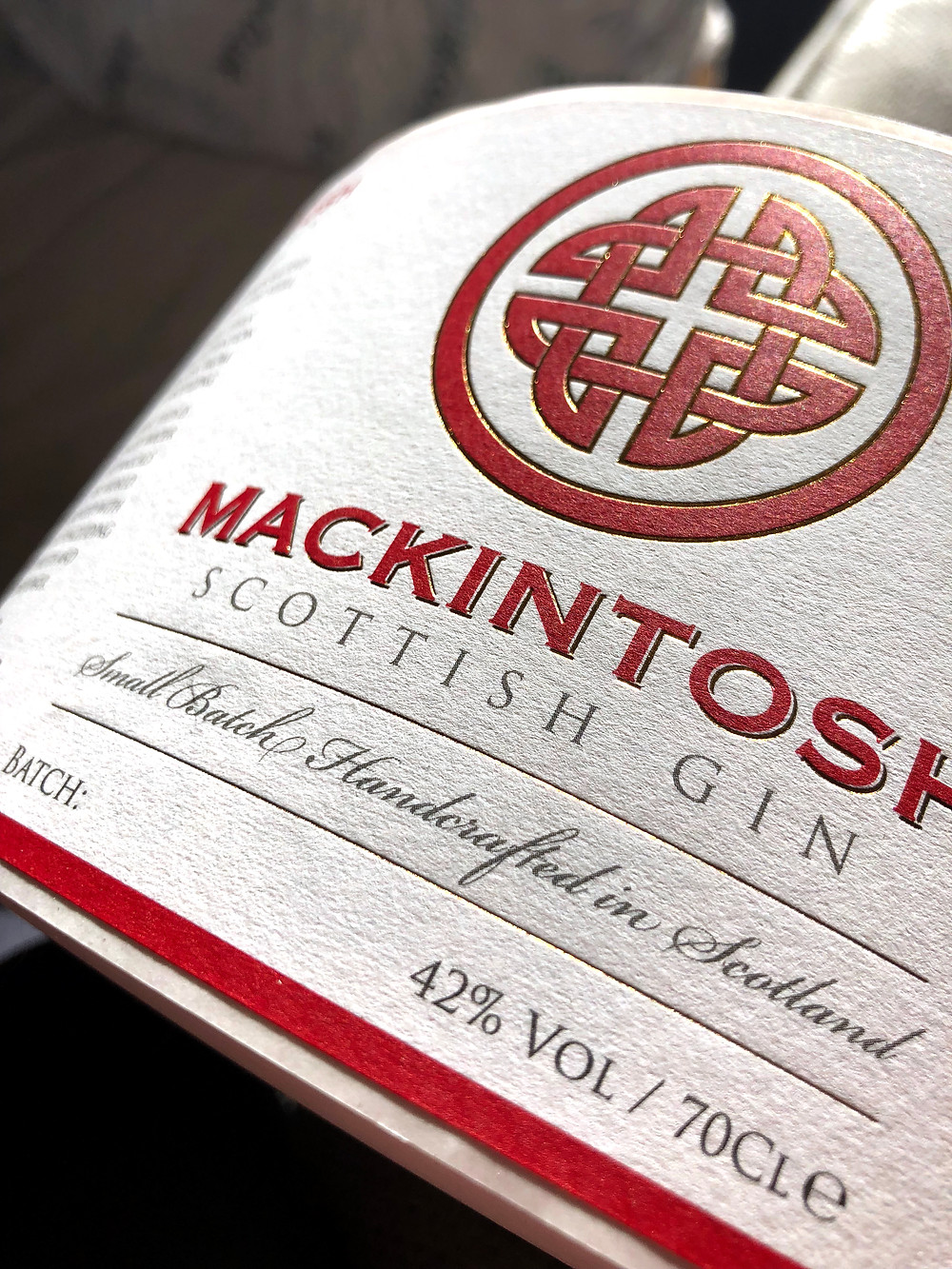 Gold foiled embossed labels for Mackintosh Gin