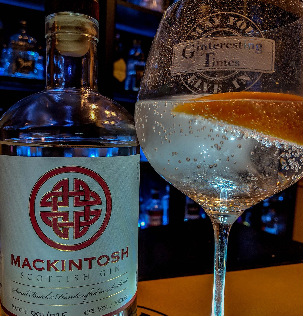 Mackintosh Gin review by Ginteresting Times in front of the gin wall bar