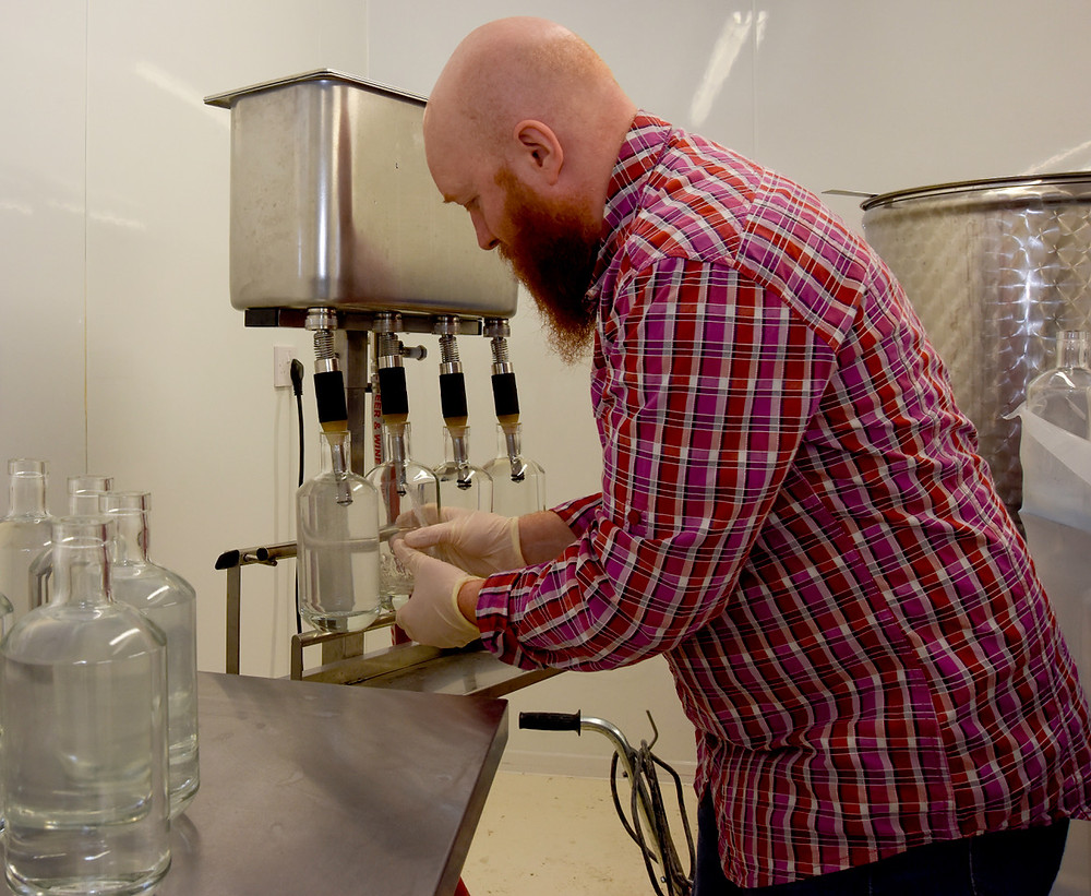 Filling the first bottles from batch one of Mackintosh Gin