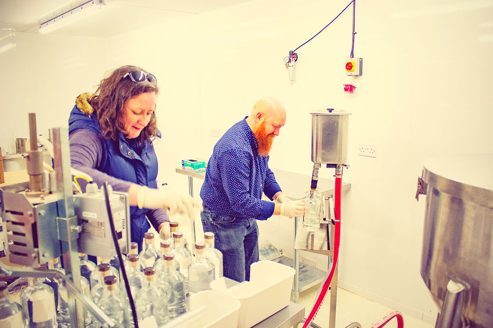 A new batch/batch 2 of Mackintosh Gin being bottled and labelled by owners James and Deborah, known as Jim and Debs.