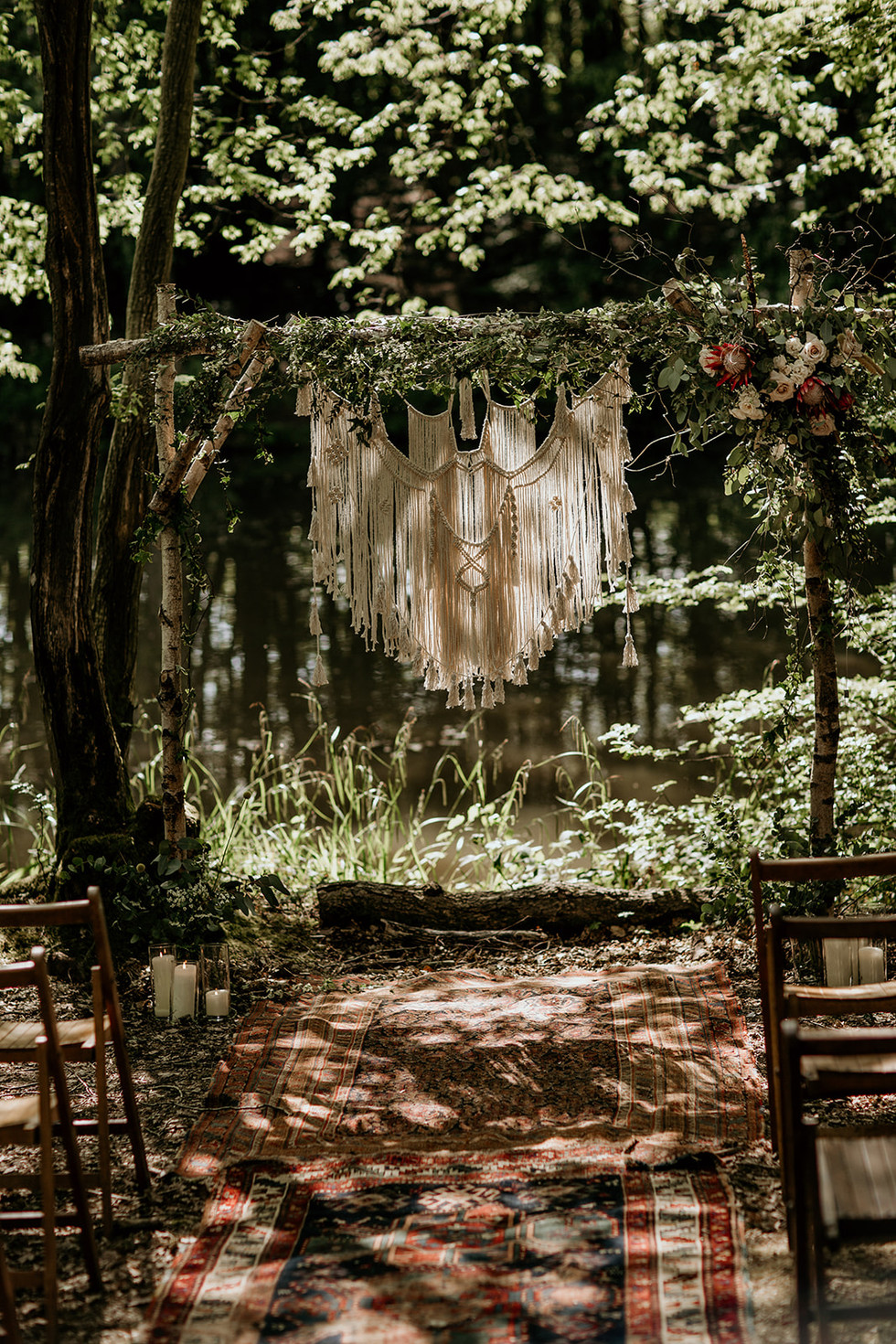 Our beautiful intimate ceremony area under the tree canopy and right on the waters edge! Ideal for smaller guest numbers.  Our bespoke silver birch ceremony arch and hanging macrame are available for hire.