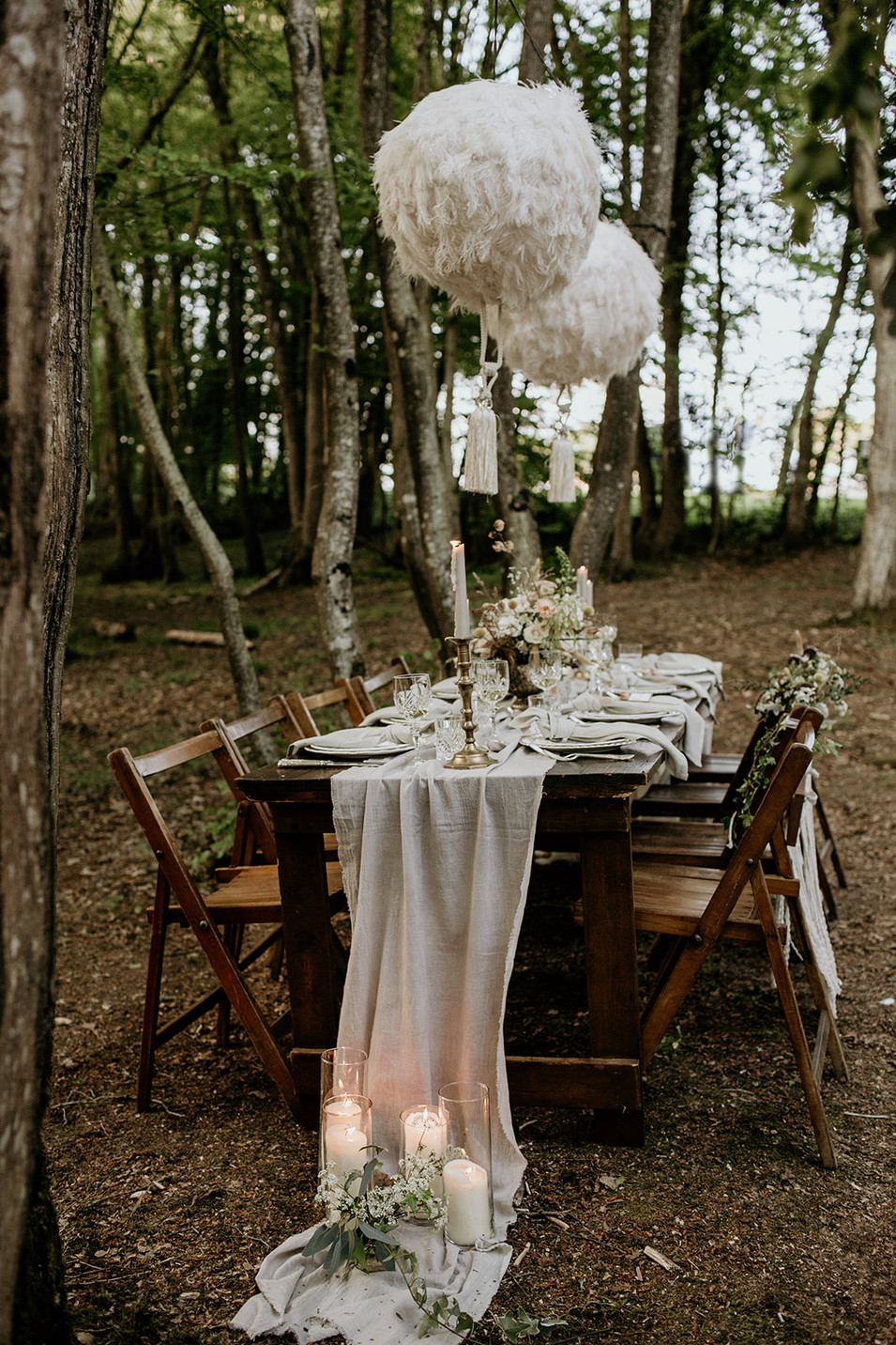 We used a naturally dyed runner, styling gauze and napkins for this set up as well as an upcycled table and authentic folding chairs.