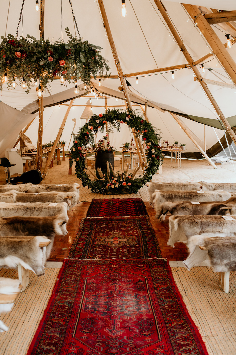 Wet wedding - For those with concerns about what to do if it rains, this will hopefully ease your mind! Here is a ceremony setup inside a tipi, showing it can look just as beautiful inside as outside! Adding a real intimate, atmospheric vibe.