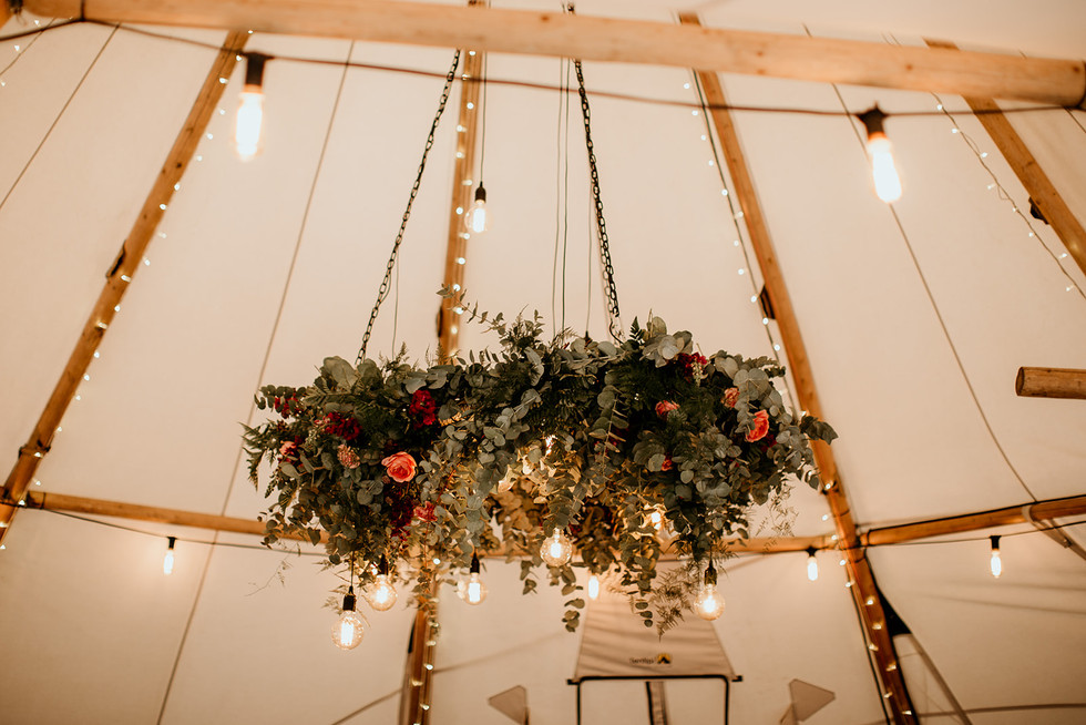 Hanging floral displays are proving really popular for tipi weddings, such a great way of adding a real statement peice!