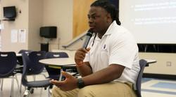 Christan Rainey speaks to students