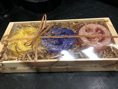 3 loofahs soaps in wooden crate
