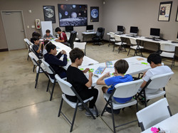 Campers Working with Their 3D Pens