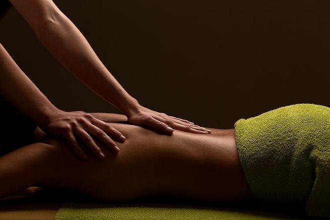 close-up masseur hands doing back massag
