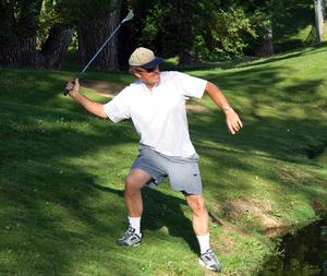 Man throughing golf club.