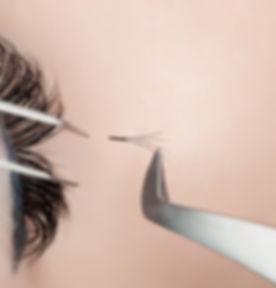 Eyelash extension procedure close up. Be