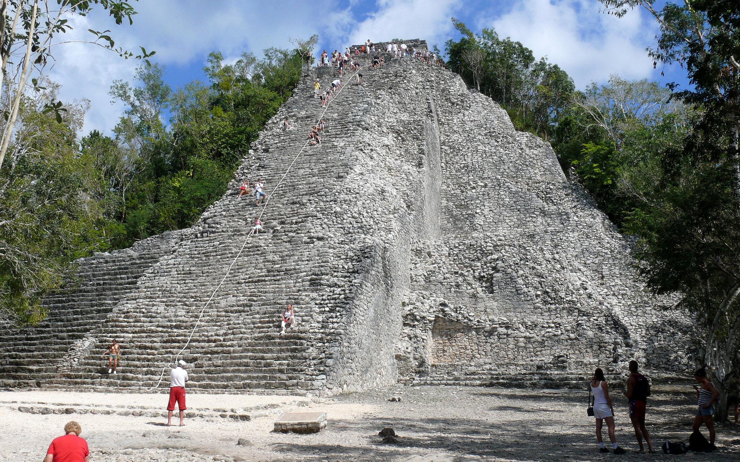 People Climbing Pyramid