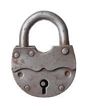 The old big padlock isolated on white ba