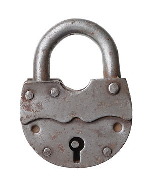 The old big padlock isolated on white ba