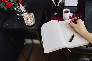 kaboompics_Woman writing on notebook.jpg