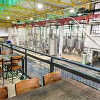 Architectural interior at R. Shea Brewing, showing the realtionship between the restaurant and the brewing floor.