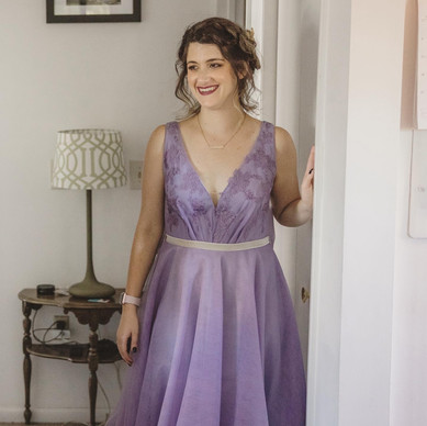 Custom purple tulle bridal gown with lace applique on the bodice