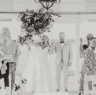 Custom strapless silk wool wedding dress with tiered skirt