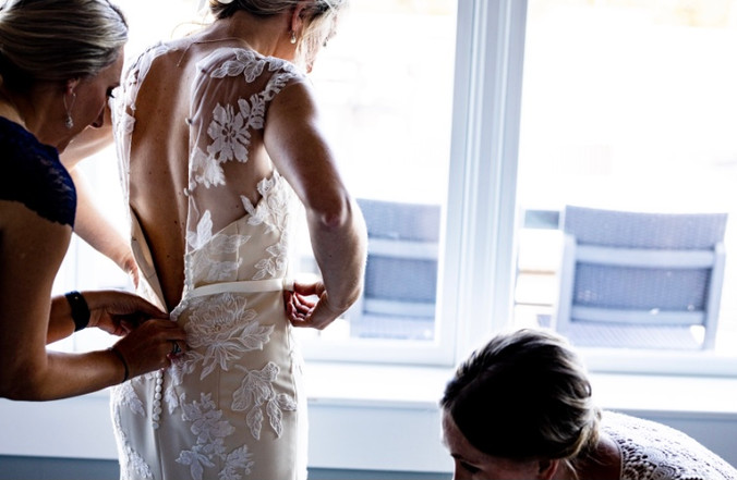 Custom stretch crepe wedding dress with French lace applique on illusion tulle