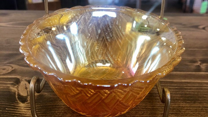 Carnival glass dish with woven glass pattern