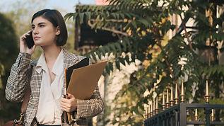 attractive-businesswoman-looking-confident-talking-HWJAXHX.jpg