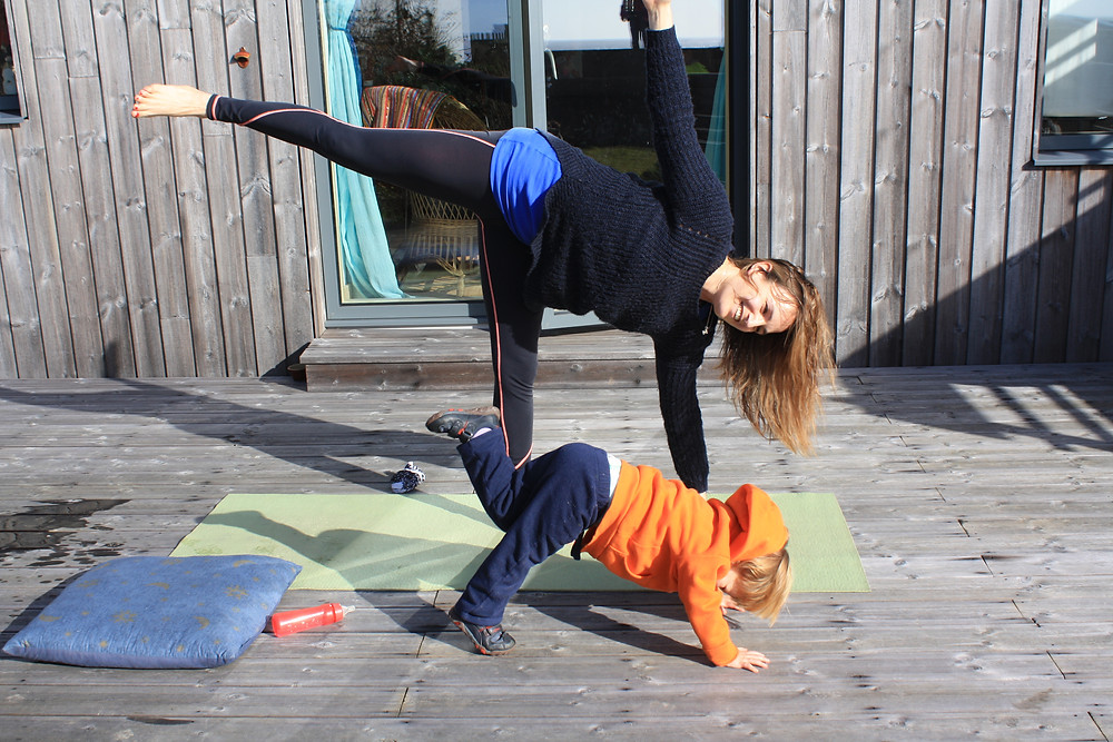 Anya Hayes doing yoga with her son Maurice