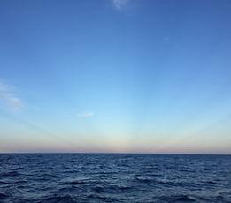 blue water under beautiful sky