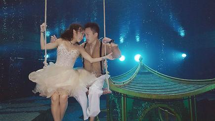 Underwater Wedding Photo with White suit