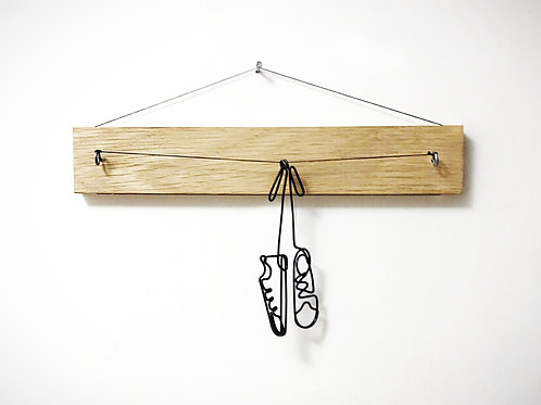 Shoes on wooden stick