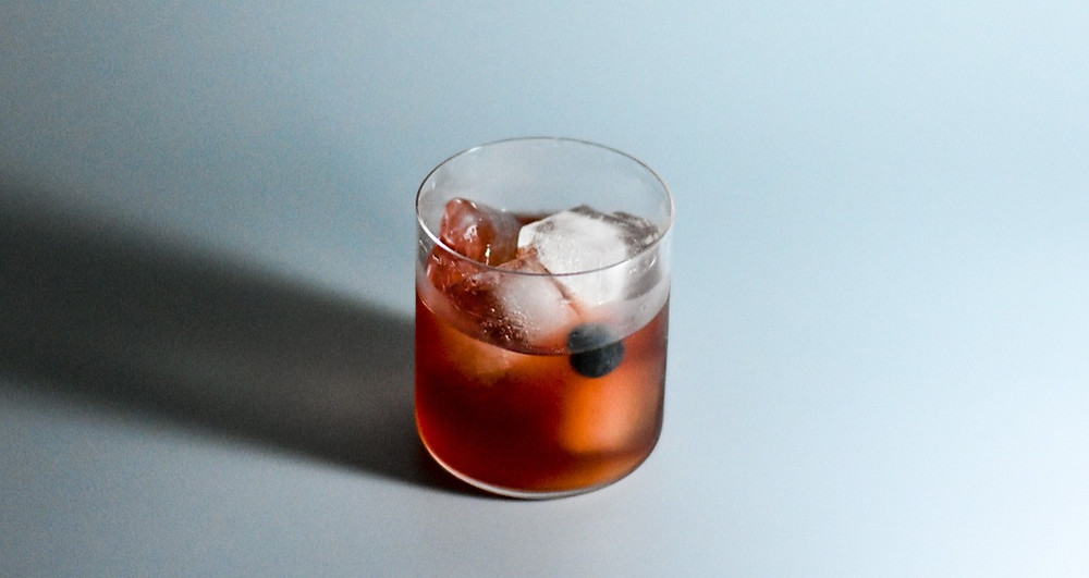 Rocks Glass, Red Liquid, ice and cherry