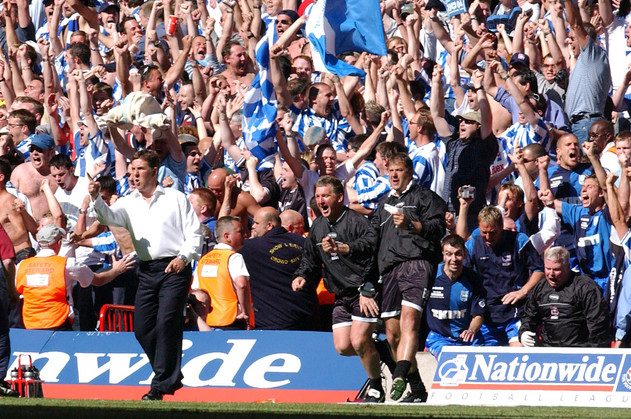 Brighton's Manager Mark McGhee reacts as his team score during the Play off finals in Cardiff