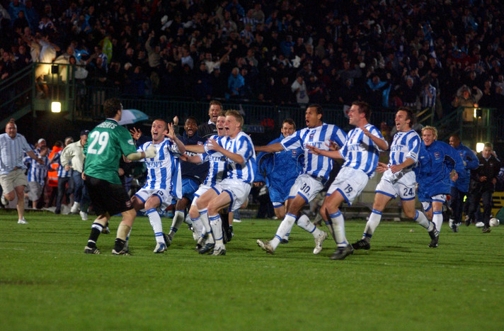 Brighton's Ben Roberts is mobbed after his penalty save puts the team through to the 2004 Play Off Finals