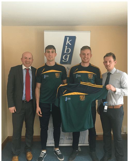 Mark Reilly and Martin Dunne  Present training tops to Shercock GFC