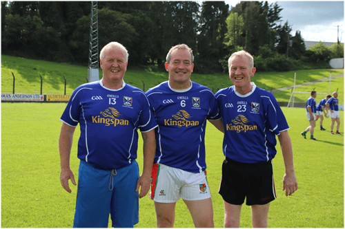 Pat Cassidy (number 13) and Peter Cassidy (number 23), Platinum Tanks Ltd, staunch Monaghan supporters, wearing the Cavan jerseys for the evening, with Ciaran Brady partner KBG in center, played for Cavan Legends team in Joe McCarthy Legends Charity game.