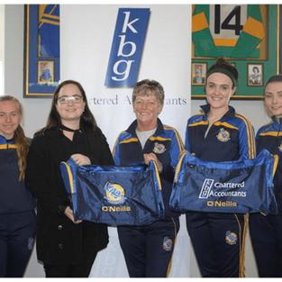 Louise Quinn  Presents gear bags to Aughawillan ladies