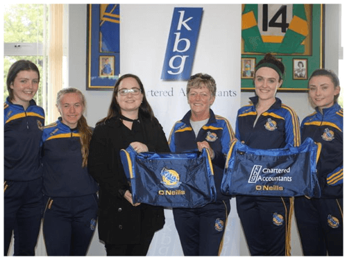 Louise Quinn  Presents gear bags to Aughawillan ladies