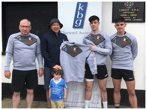 Mark Reilly  Presents training tops to Lavey GFC and his colleague Gerard Smith