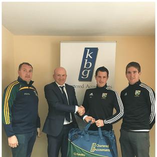 Mark Reilly  Presents gear bags to Ballyhaise GFC