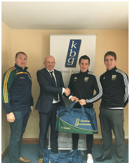 Mark Reilly  Presents gear bags to Ballyhaise GFC