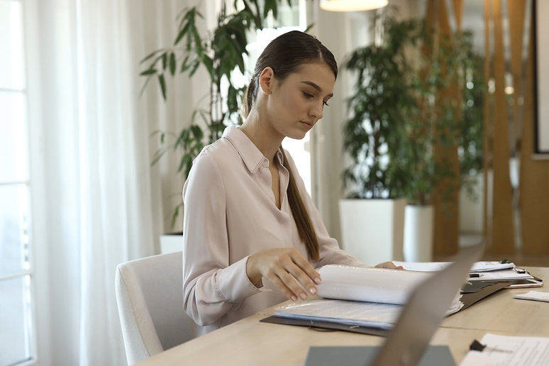 KBG accountant with paperwork